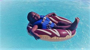 child reclining in pool