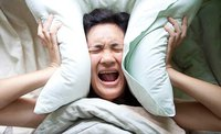 Woman Screaming with pillow
