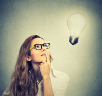 Woman thinking with lightbulb idea